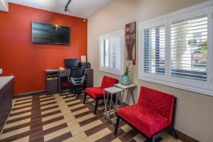 A television and/or entertainment center at Super 8 by Wyndham San Bruno /SF Intl Arpt West