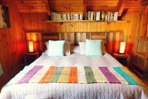 A bed or beds in a room at Lounge Brasil Hostería Boutique