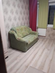 Гостиная зона в Apartment Bulvar Stroiteley 46