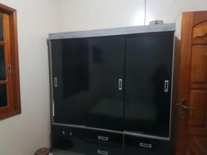 A television and/or entertainment center at Casa da Dona Leia