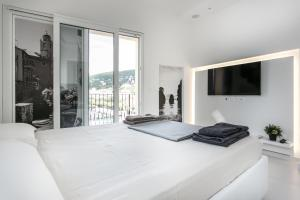 Letto o letti in una camera di Al Molo Sea View Rooms