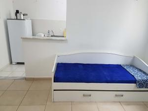 A bed or beds in a room at Apartamento no Dalas Park Residencial