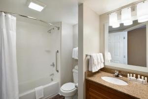 A bathroom at TownePlace Suites Denver Downtown