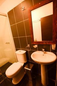 A bathroom at KW Hotel
