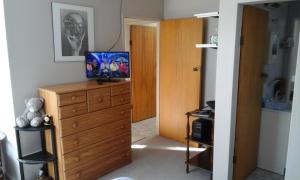 A television and/or entertainment center at Glenview Hometel