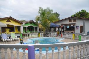 The swimming pool at or near Rainbow Village