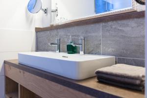 Ein Badezimmer in der Unterkunft Garten - Hotel Sallerhof
