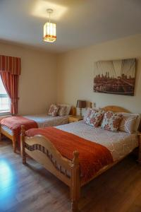 A bed or beds in a room at Kilcar Lodge