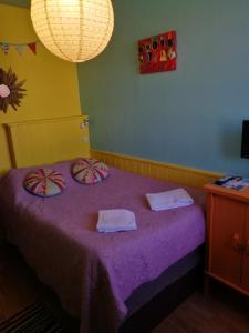 Un ou plusieurs lits dans un hébergement de l'établissement Motel Saint Georges d'Oléron