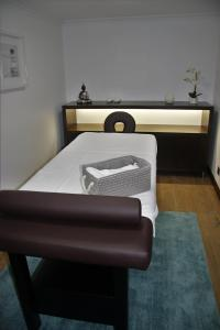A bed or beds in a room at O Casario