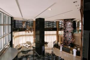 A restaurant or other place to eat at Pearl Rotana Capital Centre