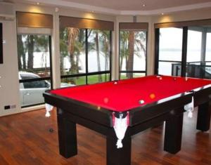 A pool table at Victoria Lakeside House