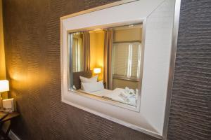 Ein Badezimmer in der Unterkunft Ambiente Apartments