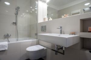 A bathroom at Apartamenty Starówka - Melody