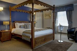 A bed or beds in a room at Philipburn Hotel, BW Signature Collection