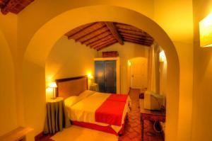 Uma cama ou camas num quarto em Hotel Rural Monte Da Rosada
