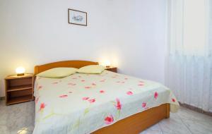 Кровать или кровати в номере Apartments Iris