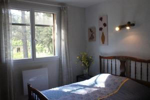 A bed or beds in a room at B&B Le Petit Frigouyé