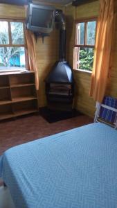Cama ou camas em um quarto em Pousada Recanto Tucano
