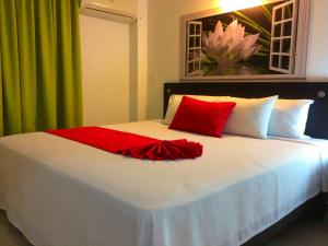 A bed or beds in a room at Hotel Chilimaco