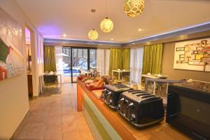 Restaurant ou autre lieu de restauration dans l'établissement Eden Appartel