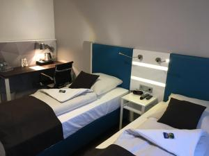A bed or beds in a room at Best Western Hotel Mannheim City