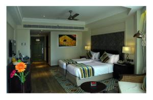 """A bed or beds in a room at Fragrant Nature Kochi - """"A Classified Five Star Hotel"""""""