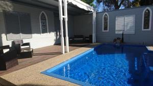 The swimming pool at or near The Convent Boutique Accommodation & Cafe
