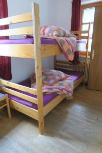 A bunk bed or bunk beds in a room at SnowBunnys BackPackers Hostel