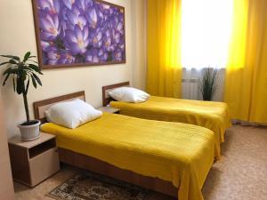 Кровать или кровати в номере Гостиница Купавна