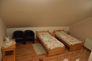 Posteľ alebo postele v izbe v ubytovaní Penzión Vínny Dom