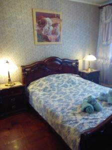 A bed or beds in a room at Apartment In Domodedovskaya