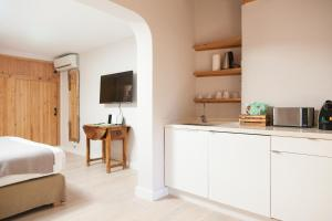 A kitchen or kitchenette at Can Aisha - Adults Only