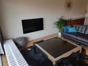 A television and/or entertainment centre at Silverbeach De Haan