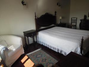 Cama ou camas em um quarto em Sótão do avô
