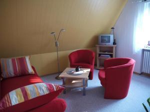 Ein Sitzbereich in der Unterkunft Ferienwohnungen Stoldt