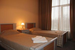 Кровать или кровати в номере Гостевой дом Тянь-Шань