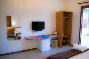 Una televisión o centro de entretenimiento en Chalés Terraviva