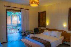 Cama o camas de una habitación en Chalés Terraviva