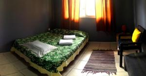 A bed or beds in a room at MOOREA - Fare Taina Iti