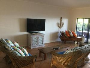 A television and/or entertainment center at ABSOLUTE BEACHFRONT BLISS @ NEWELL BEACH