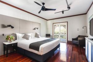 A bed or beds in a room at Cable Beach Club Resort & Spa