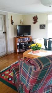 A television and/or entertainment center at Villa Helena Bed & Breakfast - Adults Only
