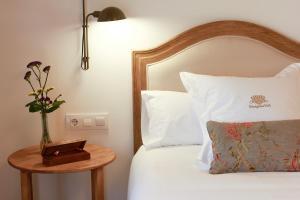 Cama o camas de una habitación en Hotel Rural Binigaus Vell