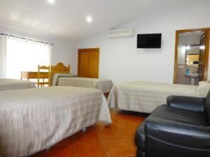 Cama o camas de una habitación en Hostal San Miguel