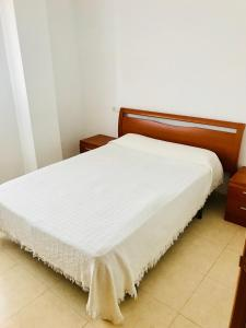 A bed or beds in a room at Aticos Deluxe Marina Dor