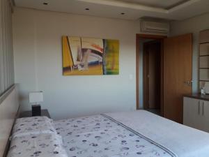 A bed or beds in a room at Apartamento de alto padrão