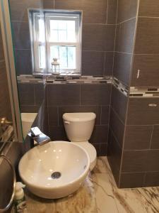 A bathroom at Brooklyn Hidden Oasis