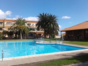 The swimming pool at or near Appartamento IL GABBIANO