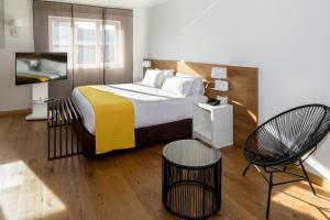 A bed or beds in a room at Rafaelhoteles Atocha
